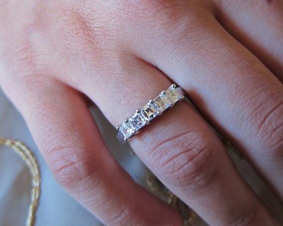 Asscher cut diamonds on common prong wedding band