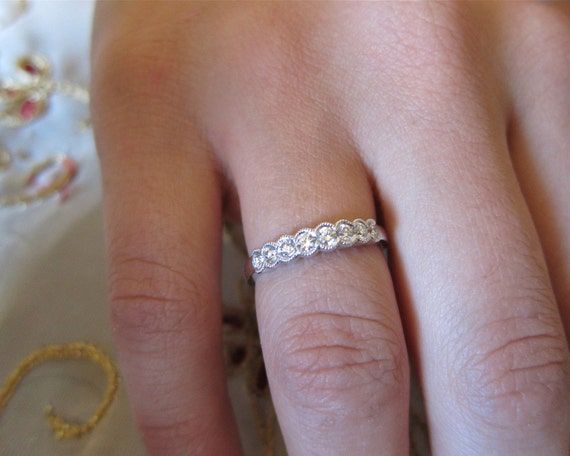 18K white gold half moon bezel set wedding band