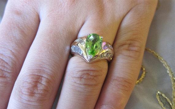 Green peridot pear shape & baguette diamonds on 14K yellow gold ring