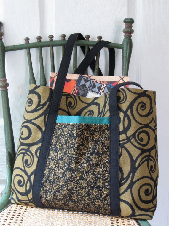 Knitting bag with gold and black spiral pattern and side pockets with beads