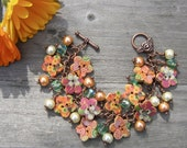 Floral button bracelet, orange, pink and green.