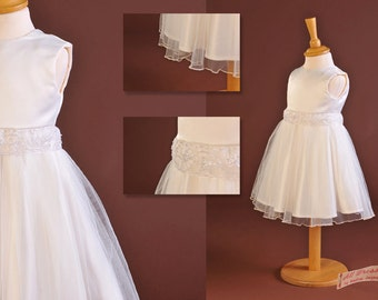 Ivory duchess satin, round neck, bridesmaid/flower girl/christening dress. Single layer tulle over skirt with beaded organdi waist trim.