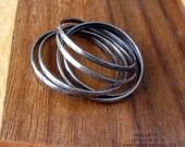 Womens Interlocking Rings: Modern, Industrial Criss Cross Rings.