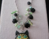 Black Cat Charm Necklace with Tiger Lily Cat with Fish Pendant and Green and Black Beads