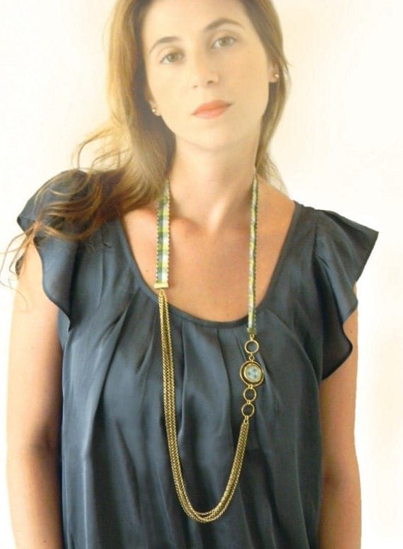Layered necklace - brass chains with green ribbon, rings and enamel pattern pendant