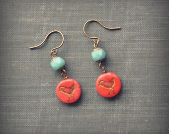 turquoise and red bird earrings.