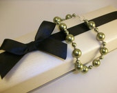 SALE - Light Green Swarovski Pearl Bracelet with Sterling Silver Diamond-cut Spacers and Spring Clasp