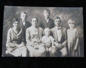 Vintage Family Photograph Serious Family of Seven     Circa 1930 Vintage Photograph Postcard          RPPC