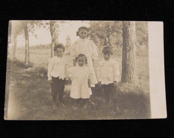 Circa 1910 Vintage Photograph Postcard    Siblings in Ruffle Cotton Whites       RPPC