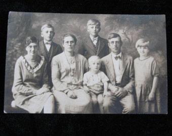Vintage Family Photograph Serious Family of Seven     Circa 1930 Vintage Photograph Postcard          RPPC