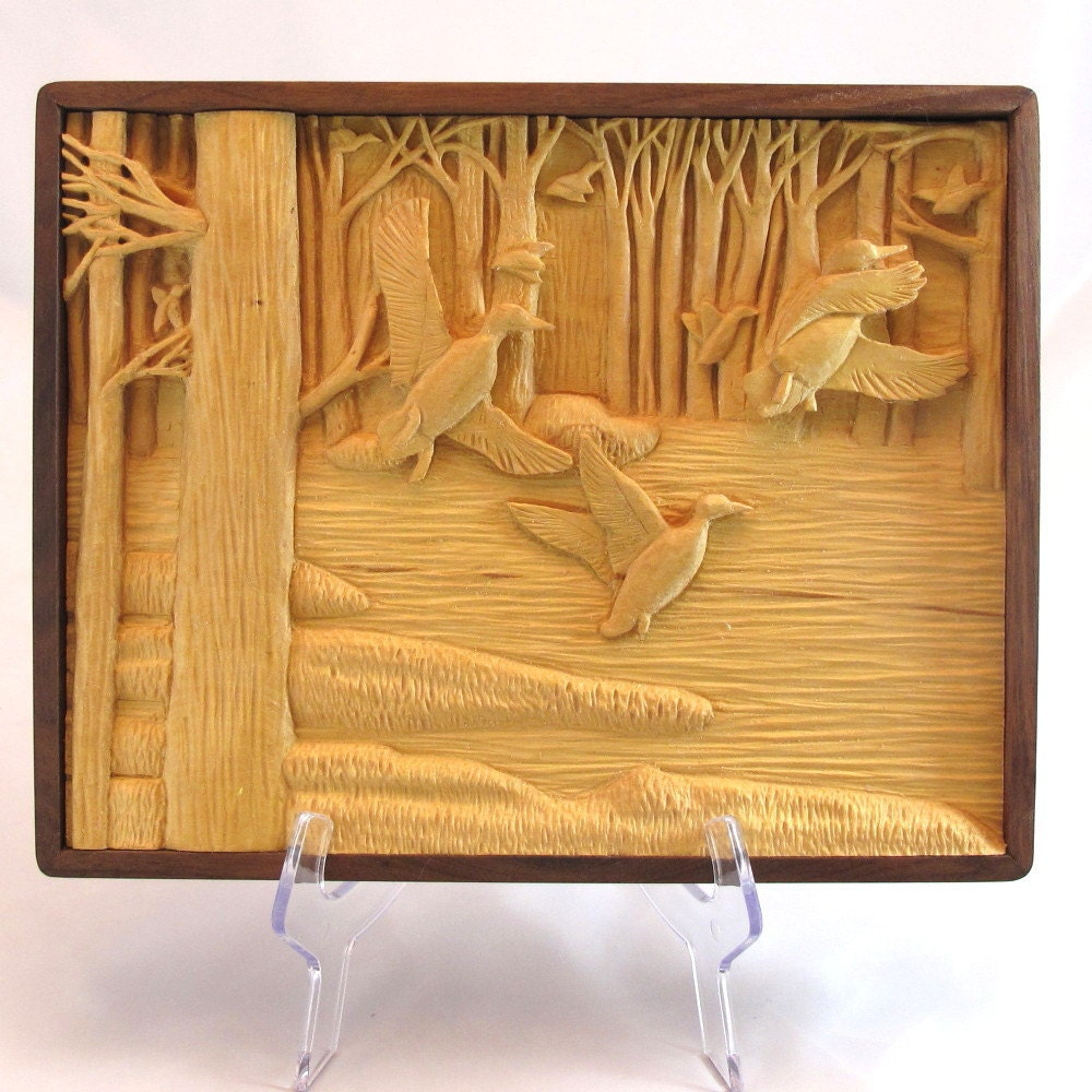 Relief carving of ducks in flight handmade walnut frame