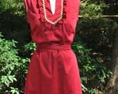 Erin: Garnet or Purple and Gold sleeveless dress with ruffle neckline