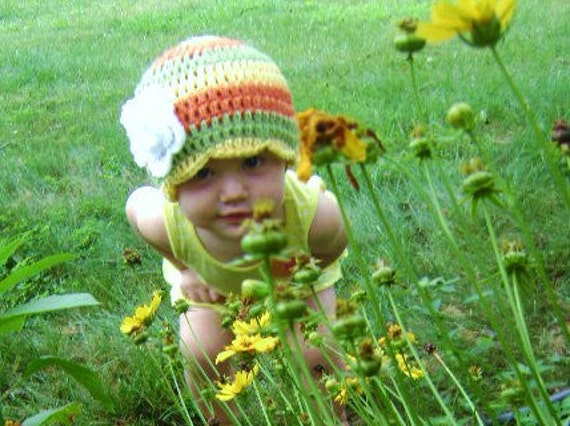 citrus striped hat with white flower