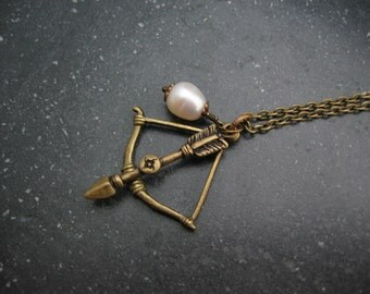 Signature Design - Bow and Arrow Necklace - Antiqued Brass Bow and Arrow, Freshwater Pearl - Survivor Jewelry - Hunger Games Inspired