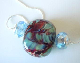 Lovely BORO handmade  lampwork on blue, pendant  207