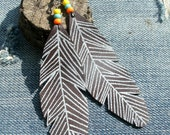 leather feather earrings with bead detail handmade from salvaged leather