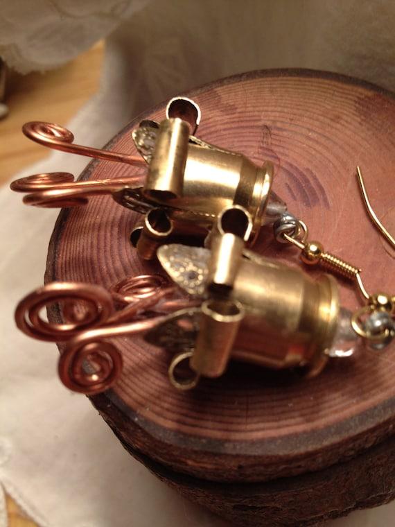 Ammo bullet flower earrings art metal sculpter handcrafted zombie copper lilies