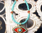 Michal Golan Turquoise and orange eye charm on beaded neckless.