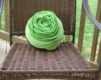 A Green Rose on Brown Pillow