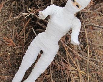 Upcycled vintage mummy girls doll with lazy eye