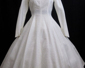 SALEVintage 1950's .New Look Wedding dress. Jacquard Taffeta.Back Plunge. Covered Buttons .Full Circle skirt. Tea length 34 28.