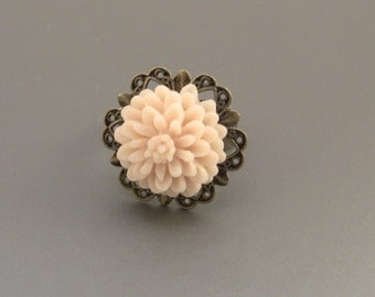 Vintage Style Bronze Filigree Starburst Ring With Cream Flower