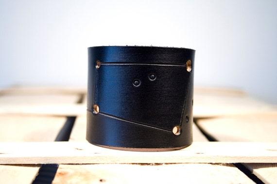 Black leather cuff Cancer constellation