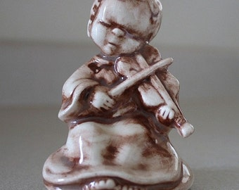 Little boy sitting down playing violin Vintage figurine