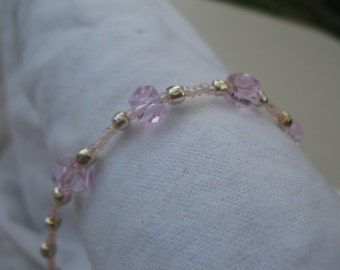 Pink crystal and glass beads bracelet.