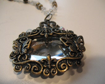 Magical mirror pendant in a shower of crystal necklace.
