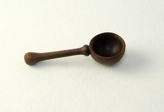 """Small Wooden Spoon in Walnut,  Approx. 1"""" wide and 2.25"""" long."""