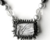 I call this beadwork necklace, BRILLIANT - black, silver and clear - beaded - one of a kind