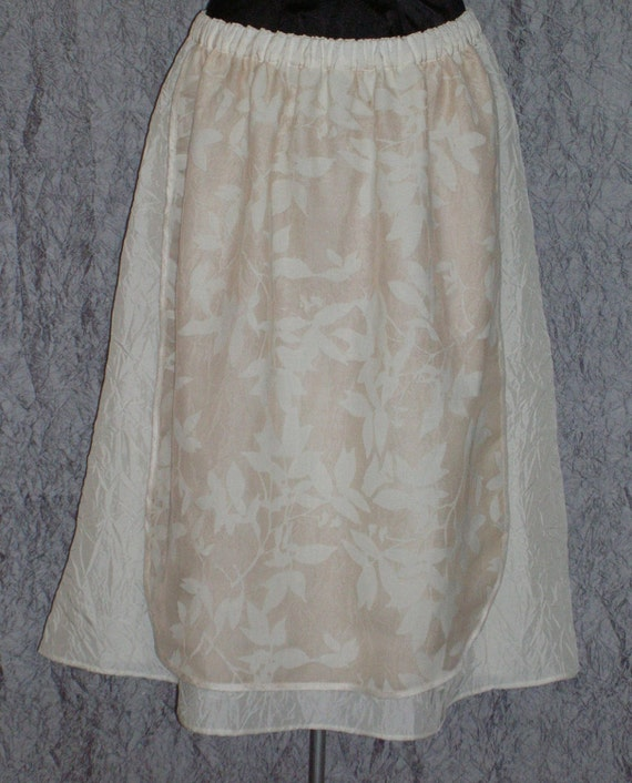 Cream Leaf Apron Over Cream Crinkle A Line Skirt Cream Skirt Size Medium to Large Cream A Line Skirt the look of Valentino