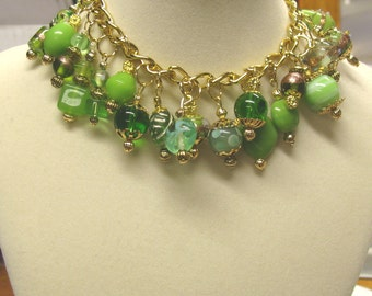 Green Lamp work glass beaded bracelet, on gold plated chain, fancy lamp work beads