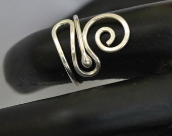 Adjustable Sterling Silver ring.  Handmade freeform.