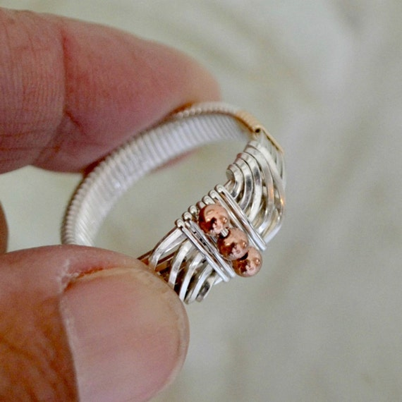 Men's Ring.  Sterling Silver with gold and copper accents.  Wire wrapped Sultan's Ring.