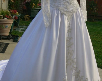 Oops The Hilton Wedding Dress with Pearls and white roses and long Train size 2