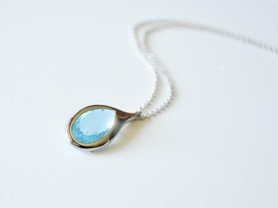 Aqua blue glass framed pendant necklace.