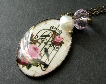 Pink Floral Birdcage Necklace in Bronze with Pink Crystal Charm and Fresh Water Pearl. Handmade Jewelry.