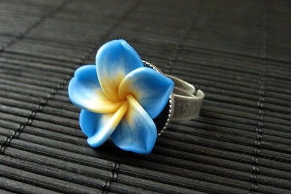 Blue Flower Ring with Yellow Center. Polymer Clay Ring. Frangipani Ring. Plumeria Ring. Silver Adjustable Ring. Handmade Jewelry.