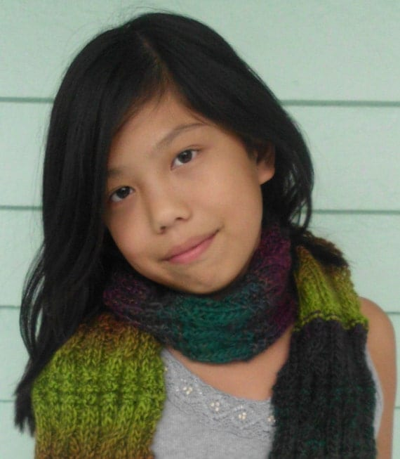 "Multicolored cable knit scarf, ""broken cable"" pattern in soft acrylic wool blend."