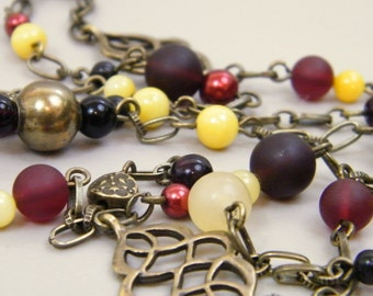 Gryffindor House Necklace - Stone Sea Glass Antique Brass Beaded Necklace Golden Yellow Antique Gold Dark Metallic Red Black