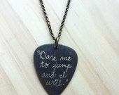 "Engraved Guitar Pick Necklace - Tom Waits lyric ""Dare me to jump and I will."""