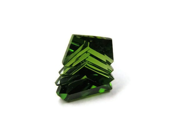 Reserved... Please do not purchase... Chrome Diopside Fantasty Cut Gemstone. 2.37 ct. Deep green color.