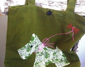 Green bag of fabric with embroidery: