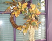 Wreath of Yellow Leaves, Purple Flowers, Pumpkins, Squashes with Raffia Bow