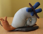 Handmade toy: Tilda's snail with dragonfly, sitting on a leaf.