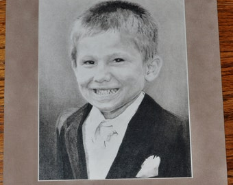 Custom/Commissioned charcoal portraits of you or someone you love