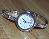 Vintage Silvertone AVON Tennis Style Bracelet Watch with Clear Crystals