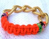 Friendship Bling Bracelet with Neon Red Stretch Cord and Chunky Gold Chain with Contrast Neon Pattern Trim